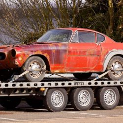 Vintage car on a tow truck