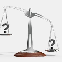 Two question marks on a balance
